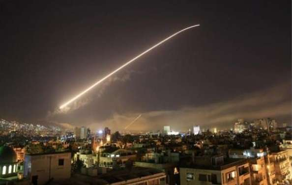 Explosions were heard in skies of capital, Damascus, and initial news spoke of Syrian army's defenses of attacking Israel, Arabic newspaper in Boston-USA-Profile News